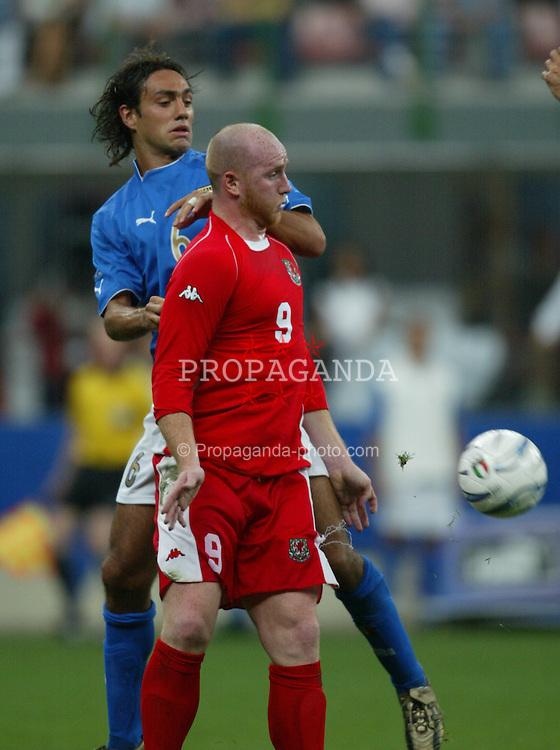 MILAN, ITALY - Saturday, September 6, 2003: Wales' John Hartson and Italy's Alessandro Nesta during the Euro 2004 qualifying match at the San Siro Stadium. (Pic by David Rawcliffe/Propaganda)