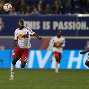 Bradley Wright-Phillips, (left), New York Red Bulls, challenged by DaMarcus Beasley, Houston Dynamo, during the New York Red Bulls Vs Houston Dynamo, Major League Soccer regular season match at Red Bull Arena, Harrison, New Jersey. USA. 4th October 2014. Photo Tim Clayton