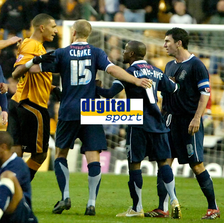 Photo: Ed Godden.<br /> Wolverhampton Wanderers v Southend United. Coca Cola Championship. 04/11/2006. Southend's Captain Kevin Maher (far right) is held back by his team mates, shortly before he was booked.