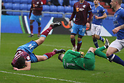 Tom Hopper Scunthorpe Forward takes a tumble with John Ruddy Oldham Goalkeeper during the EFL Sky Bet League 1 match between Oldham Athletic and Scunthorpe United at Boundary Park, Oldham, England on 28 October 2017. Photo by George Franks.