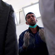 A volunteer at Benghazi morgue reacts to the news of the death of a relative killed during fighting against the Libyan army.