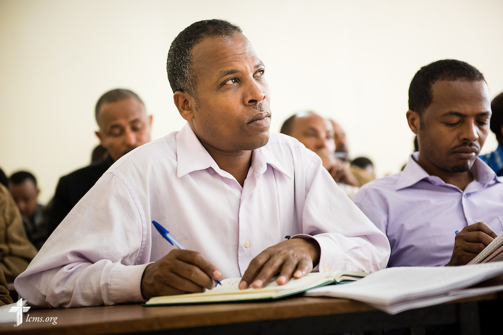 A student listens as the Rev. Dr. Alan Ludwig, a theological educator serving as a missionary in Siberia, Russia, teaches class Thursday, Nov. 13, 2014, at Mekane Yesus Seminary in Addis Ababa, Ethiopia. LCMS Communications/Erik M. Lunsford