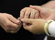 OTTSVILLE, PA - JUNE 17: Diane Chronister (L) has a wedding ring placed on her finger by Kelly Jennings (R) share a moment during their wedding ceremony performed by District Judge Gary Gambardella (not shown) June 17, 2014 in Ottsville, Pennsylvania. The judge recently announced that he will be holding evening ceremonies in case same-sex couples find it difficult to get married now that the state's ban on same-sex marriage was struck down by a federal court. (Photo by William Thomas Cain/Cain Images)