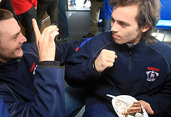 "Gregor Poloncic ""interviewing"" David Rodman at whale watching boat when Poloncic (18), Golicic (17), Rebolj (27) and Razingar (9) were celebrating an anniversary of playing for Slovenian National Team for 100 (120) times, during IIHF WC 2008 in Halifax,  on May 07, 2008, sea at Halifax, Nova Scotia,Canada.(Photo by Vid Ponikvar / Sportal Images)"