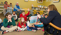 "Author Elizabeth Howard reads ""A Day with Bonefish Joe""  to Mrs. Gressner's 2nd and 3rd grade students from Holy Trinity School at the Laconia Library on Tuesday afternoon.  (Karen Bobotas/for the Laconia Daily Sun)"