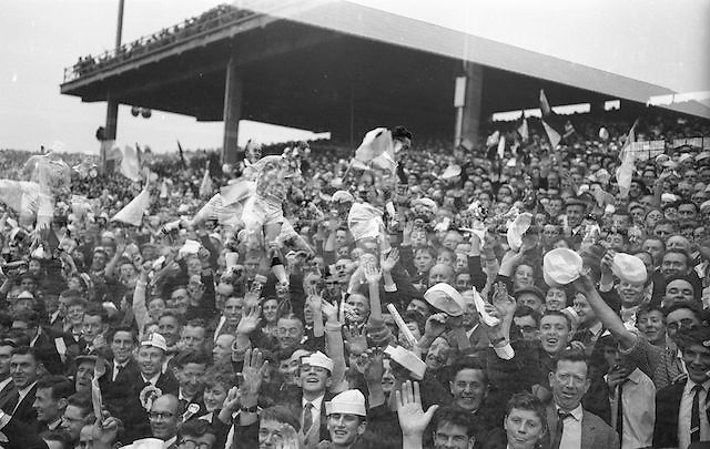 Supporters waving and cheering during the All Ireland Senior Gaelic Football Championship Final Dublin v Galway in Croke Park on the 22nd September 1963. Dublin 1-9 Galway 0-10.