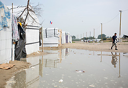 © Licensed to London News Pictures. 30/08/2015. Calais, France. Tents at the refugee camp in Calais, also known as the Jungle, are surrounded by puddles after last night's downpour. Tomorrow the French PM, Manuel Valls, will visit the day centre Jules Ferry at the camp. Photo credit : Isabel Infantes/LNP