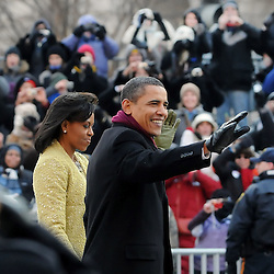 President Barack Obama and First Lady Michelle Obama walk down Pennsylvania Avenue in Washington DC during the Inaugural Parade.