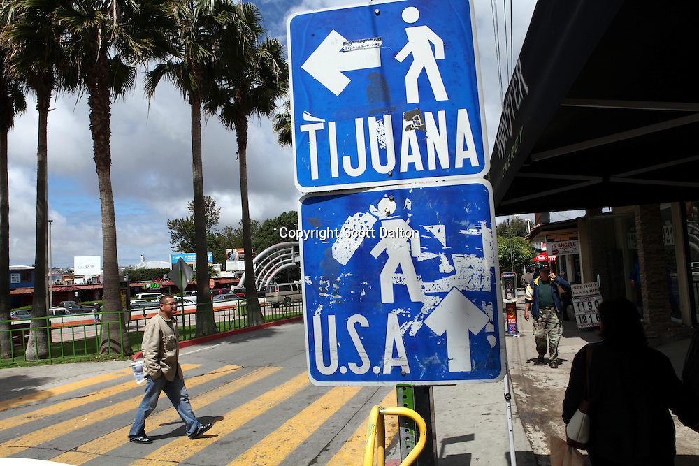 Signs in Tijuana, Mexico point the way to the US border crossing and downtown Tijuana on April 28, 2010. (Photo/Scott Dalton)