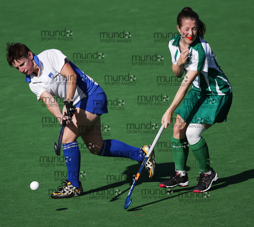 (Canberra, Australia---21 April 2013) Australian National University Women's Hockey Club (ANUWHC in blue and white) plays the St Pats women's hockey team (green and white) in round four action of Canberra / ACT State League field hockey action at the National Hockey Centre.