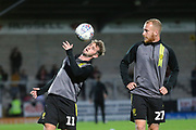 Burton Albion midfielder David Templeton (11) and Burton Albion forward Liam Boyce (27) warm up during the EFL Cup match between Burton Albion and Bournemouth at the Pirelli Stadium, Burton upon Trent, England on 25 September 2019.