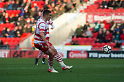 Doncaster Rovers Midfielder Tommy Rowe (10) shoots and scores a gaol 1-0 during the The FA Cup match between Doncaster Rovers and Scunthorpe United at the Keepmoat Stadium, Doncaster, England on 3 December 2017. Photo by Craig Zadoroznyj.