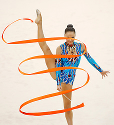 Azerbaijan's Dinara Gimatova performs with the ribbon during the individual all-around qualifications for rhythmic gymnastics during the Olympic games in Beijing, China, 22 August 2008.