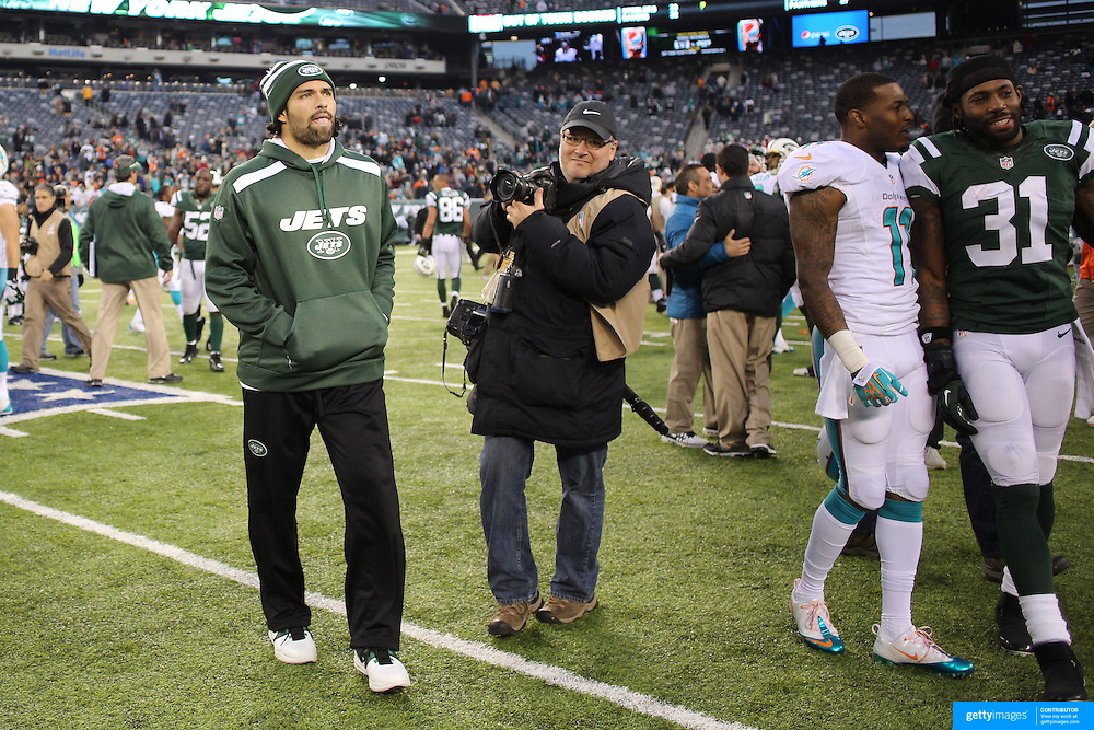 Injured New York Jets quarterback Mark Sanchez at the end of the game during the New York Jets Vs Miami Dolphins  NFL American Football game at MetLife Stadium, East Rutherford, NJ, USA. 1st December 2013. Photo Tim Clayton