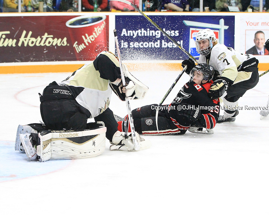 TRENTON, ON - Apr 18, 2016 -  Ontario Junior Hockey League game action between Trenton Golden Hawks and the Georgetown Raiders. Game 3 of the Buckland Cup Championship Series  at the Duncan Memorial Gardens in Trenton, Ontario. Daniel Hardie #15 of the Georgetown Raiders is halled down in the crease during the third period by Brandon Marinelli #7 of the Trenton Golden Hawks.<br /> (Photo by Tim Bates / OJHL Images)