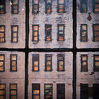 Antique glass window distorts the outside view of New York City.