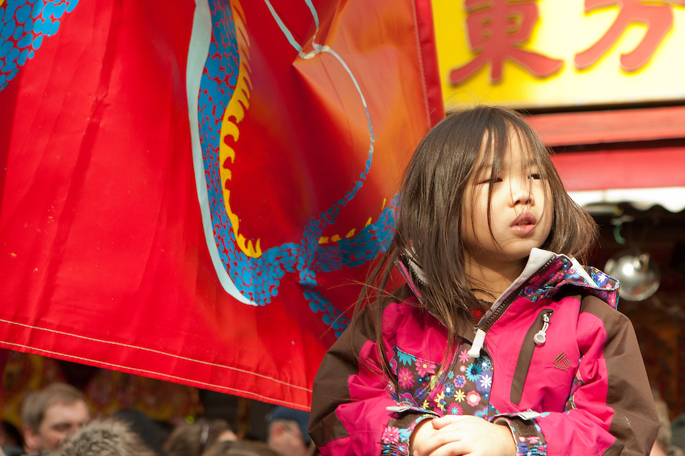 A young spectator waiting for the parade to start.