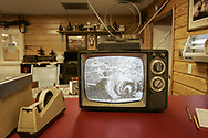In the dining room of 2 J'S Country Store, an old TV set show a fuzzy image of incoming hurricane Rita as wind built up over Devers. The hurricane was due to landfall that night. 09/24/2005.