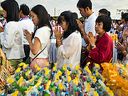 01 JANUARY 2016 - BANGKOK, THAILAND:   People pray during the annual New Year's mass merit making ceremony on at Sanam Luang in Bangkok. The ceremony is sponsored by the Bangkok city government. More than 500 Buddhist monks participated in the ceremony this year. Thais usually go to temples and religious observances to meditate and make merit on New Year's Day.       PHOTO BY JACK KURTZ