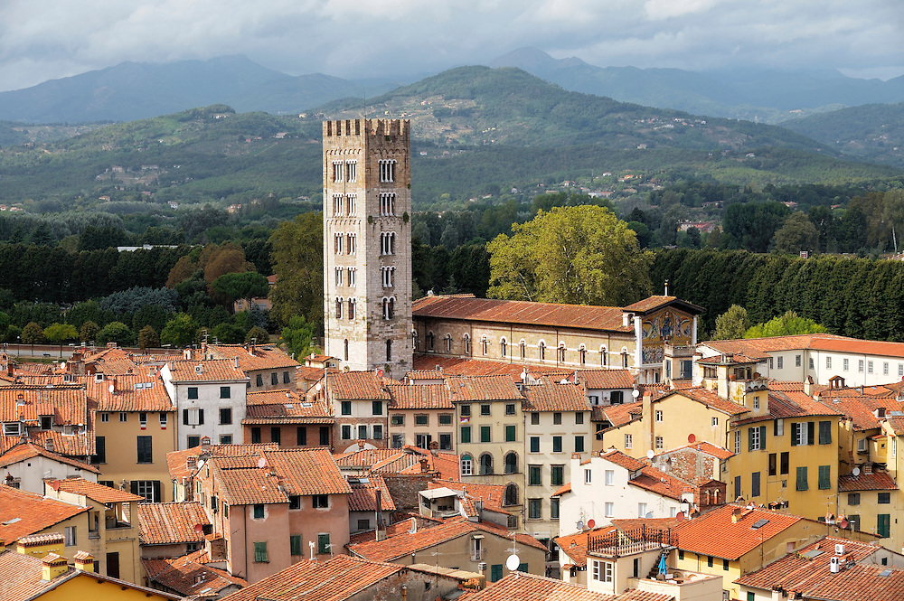 The tower of the Basilica di San Frediano rises above the mediaeval city of Lucca, Tuscany, Italy