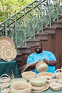 Corey Alston making sweetgrass baskets at the Charleston City Market. Alston is a 5th generation basket maker.