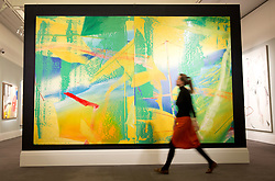 "© Licensed to London News Pictures. 22/02/2018. LONDON, UK. A member of staff walks pass  ""Gelbrün"" (1982) by Gerhard Richter with an estimate of £7,000,000 - 10,0000, on display at Sotheby's photo call for highlights from their forthcoming sales of Impressionist, Modern, Surrealist and Contemporary Art. Photo credit: ISABEL INFANTES/LNP"