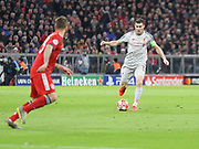 James Milner of Liverpool with the ball during the Champions League round of 16, leg 2 of 2 match between Bayern Munich and Liverpool at the Allianz Arena stadium, Munich, Germany on 13 March 2019.