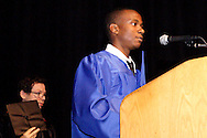 Dayton Board of Education member Joseph Lacey (left) removes his hat as Davion Heath recites the Pledge of Allegiance during the Paul Laurence Dunbar High School commencement in the Dayton Convention Center in downtown Dayton, Wednesday, May 23, 2012.