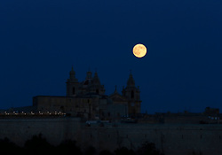 The supermoon rises over the cathedral in Mdina, Malta's ancient capital city, in the centre of the island, August 10, 2014. The astronomical event occurs when the moon is closest to the Earth in its orbit, making it appear much larger and brighter than usual.<br /> REUTERS/Darrin Zammit Lupi (MALTA)