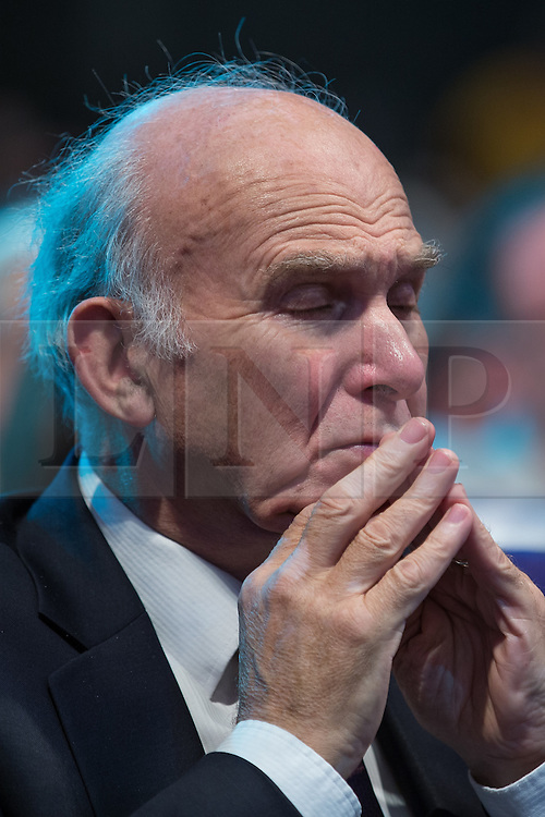 © Licensed to London News Pictures . 08/10/2014 . Glasgow , UK . VINCE CABLE sits waiting for Deputy Prime Minister and Party Leader , Nick Clegg , to deliver his keynote speech at the close of the conference . The Liberal Democrat Party Conference 2014 at the Scottish Exhibition and Conference Centre in Glasgow . Photo credit : Joel Goodman/LNP
