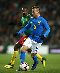 Brazil's Arthur (right) and Cameron's Karl Koko Ekambi battle for the ball