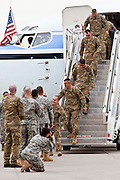 "15 JANUARY 2012 - PHOENIX, AZ:    Returning soldiers file off an airplane at the The 161st Air Refueling Wing of the Arizona Air National Guard in Phoenix. About 100 soldiers of A (Alpha) Company of the 422nd Expeditionary Signal Battalion (referred to as ""Alpha 4-2-2"") of the Arizona Army National Guard returned to Arizona on Sunday, Jan. 15, following a nearly year-long deployment to Afghanistan. More than 10,000 Arizona Army and Air National Guard Soldiers and Airmen have been ordered to federal active duty in support of Operations Noble Eagle, Enduring Freedom, Iraqi Freedom, and New Dawn since September 2001. Approximately 200 Arizona National Guard Soldiers and Airmen are still serving on federal active duty overseas.  PHOTO BY JACK KURTZ"