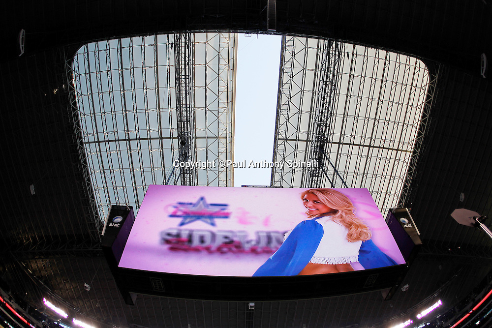 The roof begins to open in this wide angle general view of the giant scoreboard and interior of Cowboys Stadium during the Dallas Cowboys NFL week 3 football game against the Washington Redskins on Monday, September 26, 2011 in Arlington, Texas. The Cowboys won the game 18-16. ©Paul Anthony Spinelli