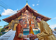 Laos. Luang Prabang. Wedding couple at Wat Xiang Thong.