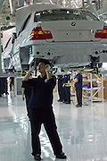 A Chinese worker assembles a BMW in a factory in Shenyang. The German luxury auto maker expects its vehicle sales in China to hit 22 thousand units in 2005, including imports. Last year (2004), BMW posted a 16 percent fall in vehicle sales in China to 15 thousand units, including imports. BMW makes its luxury sedans in China with local partner Brilliance China Automotive Holdings Limited.