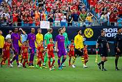 CHARLOTTE, USA - Sunday, July 22, 2018: Liverpool's captain Adam Lallana leads his side out before a preseason International Champions Cup match between Borussia Dortmund and Liverpool FC at the  Bank of America Stadium. (Pic by David Rawcliffe/Propaganda)