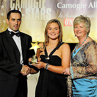 7 November 2009; Chloe Morey, Clare, is presented with her Munster Young Player of the Year award by Paul Brady, three times World Handball Champion, and Joan O'Flynn, President of the Camogie Association, during the 2009 Camogie All-Stars Awards, in association with O'Neills. Citywest Hotel, Conference, Leisure & Golf Resort, Dublin. Picture credit: Pat Murphy / SPORTSFILE *** NO REPRODUCTION FEE ***