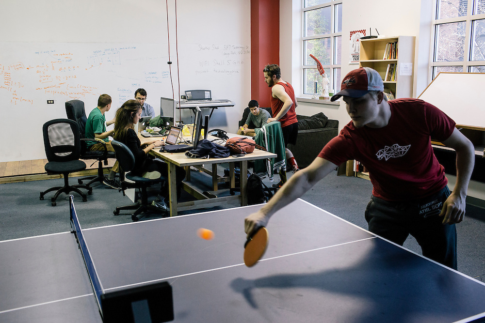Members of Startup Shell, work on various projects while Cody Branchaw , a freshman and member, takes a break by playing ping pong at the Startup Shell headquarters on the University of Maryland campus on April 1, 2015. Startup Shell is a not for profit company run entirely by and for students at UMD. Entrepreneurial students from all different disciplines apply to join and if accepted, can work on their innovative project with others collaborating and teaching one another.