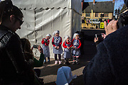 UNITED KINGDOM, Olney: 25 February 2020 <br /> The world's oldest pancake race takes place in the small market town of Olney, Buckinghamshire. It is said to have originated in 1445 when, according to tradition, a woman of Olney ran to the church after hearing the shriving bell, still dressed in her apron  and still clutching her frying pan. <br /> Pictured: Children about to take part in the children race pose for a picture.