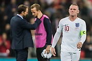 Wayne Rooney (England) in the foreground as Gareth Southgate, Head Coach of England FC talks with Harry Kane (England) in the background following the international Friendly match between England and USA at Wembley Stadium, London, England on 15 November 2018.