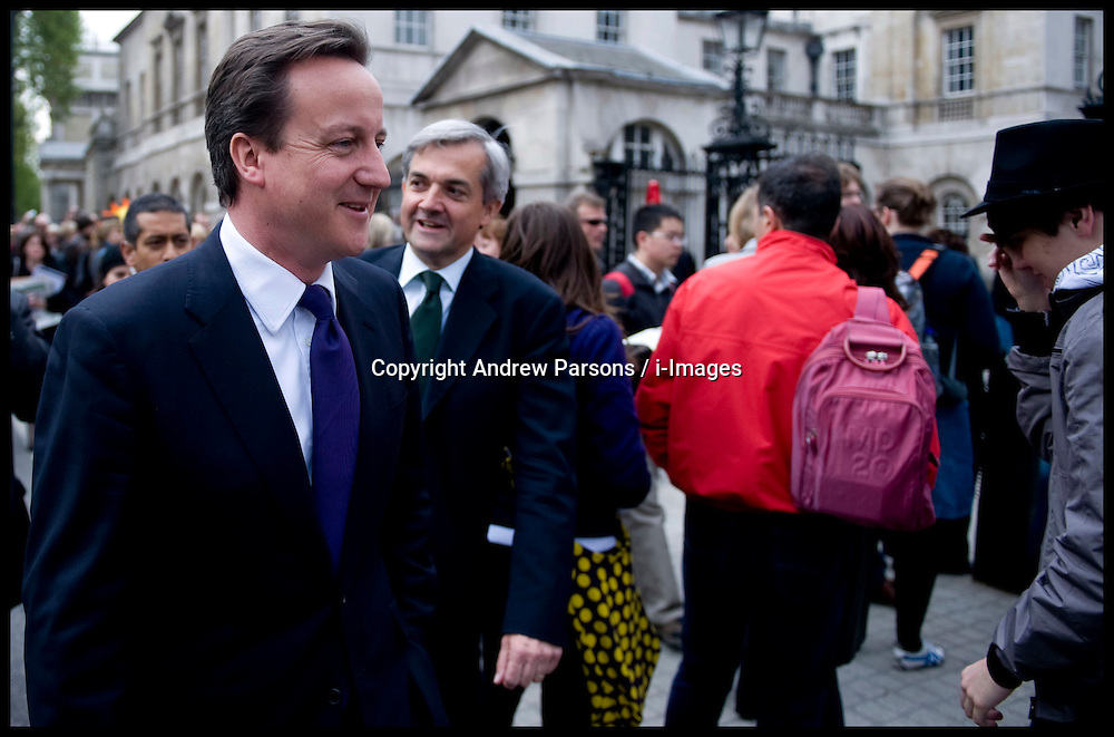 British Prime Minister David Cameron with Chris Huhne, the Secretary of State for Energy and Climate Change walking down Whitehall on their way to visit DECC, London, UK, May 14, 2010.  Photo By Andrew Parsons / i-Images.
