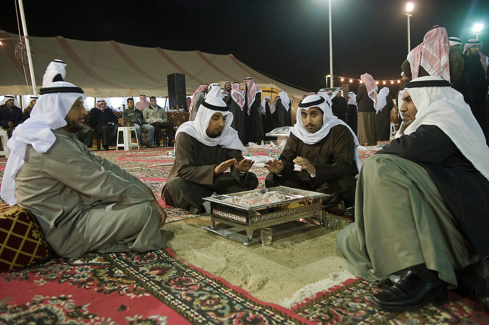 Kuwaiti men keep warm outside of the election HQ of a candidate during a Jan. 23 night time rally as temperatures dropped that night to 0 Celcius. About 320 Kuwaiti men and women are currently in the running in the February 2, 2012 parliamentary polls to elect a new 50-member National Assembly (parliament).
