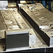 nella fotografia: lo stampo realizzato per la FIAT Panda.. Scanferla, azienda di Avigliana (TO) specializzata nella progettazione e costruzione stampi progressivi e nello stampaggio a freddo. La produzione è di circa 50 milioni di particolari metallici all'anno, destinata principalmente al mercato dell'Automotive e dell'elettroutensile.