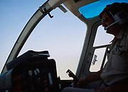 View inside cockpit go Bell 206 JetRanger helicopter over Arabian desert, Saudi Arabia oil industry 1979