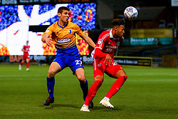 Kyle Wootton of Scunthorpe United heads the ball away from Lewis Gibbens of Mansfield Town - Mandatory by-line: Ryan Crockett/JMP - 13/11/2018 - FOOTBALL - One Call Stadium - Mansfield, England - Mansfield Town v Scunthorpe United - Checkatrade Trophy