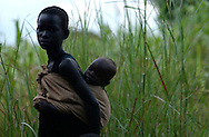 """At least, 20,000 children, women and men were abducted into Kony's army over the years and forced to take part in horrific killings as a way of brainwashing them into a culture of violence. Many young woman are forced to """"marry"""" rebel commanders, and often came home with children. (PHOTO: MIGUEL JUAREZ LUGO)."""