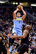 Jan 28, 2017; Phoenix, AZ, USA; Denver Nuggets forward Danilo Gallinari (8) shoots the ball over Phoenix Suns forward P.J. Tucker (17) in the first half of the NBA game at Talking Stick Resort Arena. Mandatory Credit: Jennifer Stewart-USA TODAY Sports
