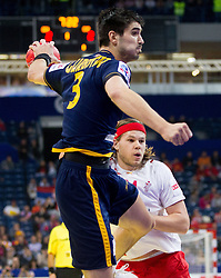 Eduardo Gurbindo of Spain vs Mikkel Hansen of Denmark during handball match between Denmark and Spain in 1st Semifinal at 10th EHF European Handball Championship Serbia 2012, on January 27, 2012 in Beogradska Arena, Belgrade, Serbia. (Photo By Vid Ponikvar / Sportida.com)