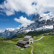 """Kleine Scheidegg pass, in the Berner Oberland, Switzerland, the Alps, Europe. The world's longest continuous rack and pinion railway (Wengernalpbahn) goes from Grindelwald up to Kleine Scheidegg and down to Wengen and Lauterbrunnen. From Kleine Scheidegg, Jungfraubahn ascends steeply inside the Eiger to Jungfraujoch, the highest railway station in Europe. UNESCO honors """"Swiss Alps Jungfrau-Aletsch"""" on the list of World Heritage Areas. This image was stitched from multiple overlapping photos."""