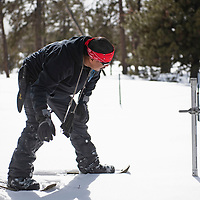 Ralphus Begay, a hydrologic technician with the Navajo Nation Department of Water measuring snowpack at the Whiskey Creek SNOTEL site in the Chuska mountains, Tuesday, Jan. 29.